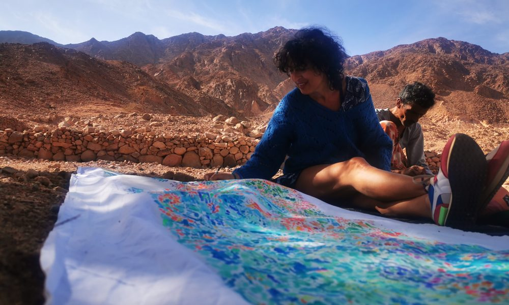 Isabelle Arvers Painting in Al Okda, a wadi (valley) that has one of the oldest well in Sinai