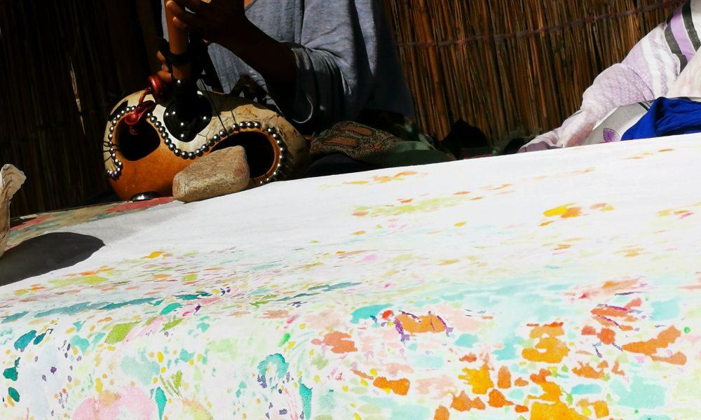 Painting with Saki Wakita playing ngoni